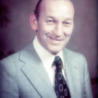 B – Lawrence M Dent, 1926 – 1990